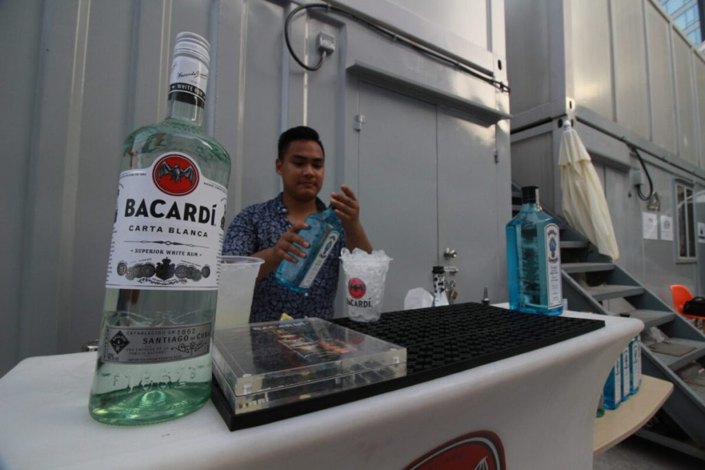 Bacardi bartender serving drinks at the Asia Yachting Weekend Brokerage Boat Show
