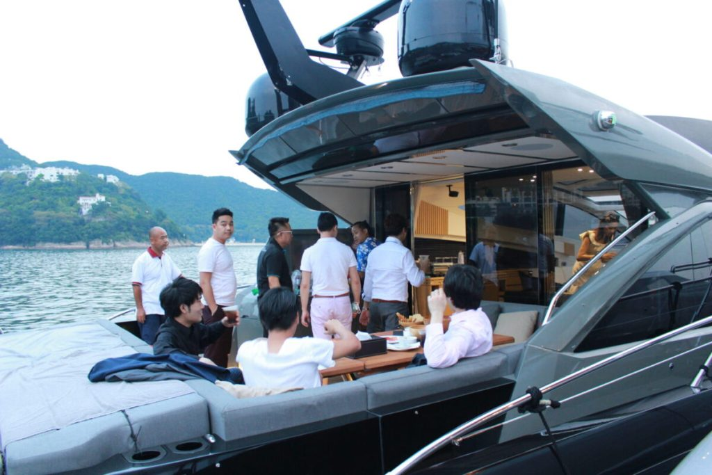 Guests mingling on the Sunseeker Predator 68 during the Asia Yachting Weekend Brokerage Boat Show Cocktail Event_1